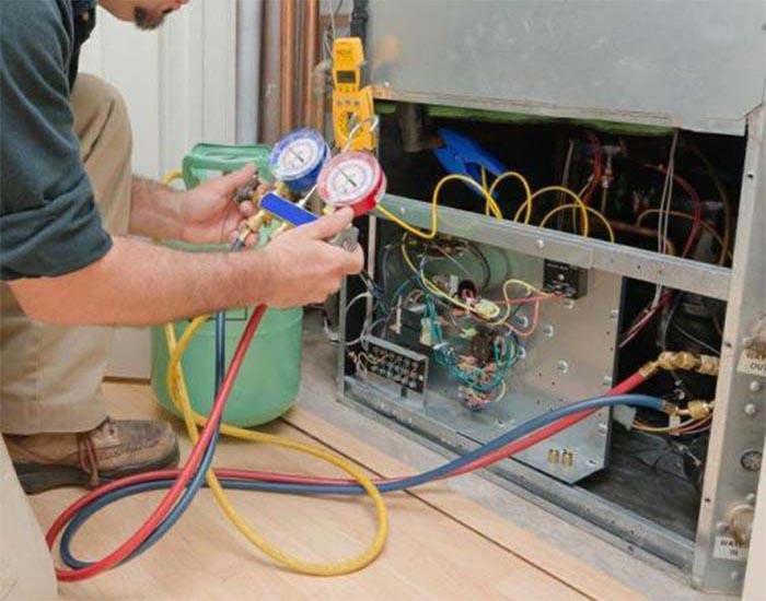 تعمیرکار شارژ گاز یخچال